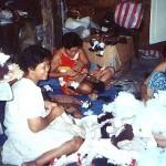 Members of MPM working the dolls