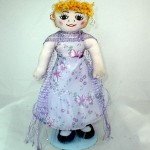 Doll with a gown dress.