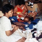 Members of MPM working on the dolls.